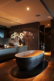 Dark moody bathroom designs that impress (2)