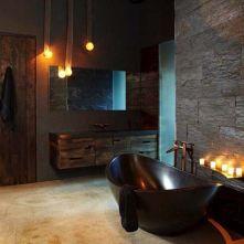 Dark moody bathroom designs that impress (23)