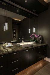 Dark moody bathroom designs that impress (7)