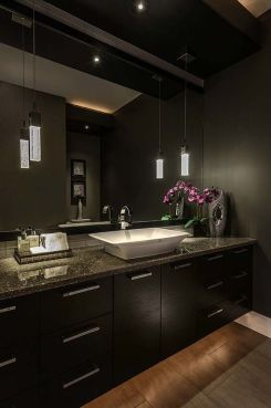 Dark moody bathroom designs that impress (7)