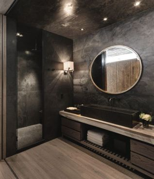 Dark moody bathroom designs that impress (8)