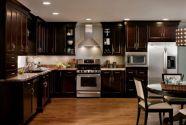 Stylish dark brown cabinets kitchen 31