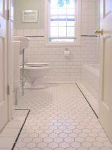 Stylish white subway tile bathroom 11