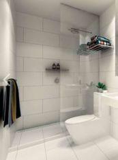 Stylish white subway tile bathroom 16