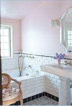 Stylish white subway tile bathroom 22