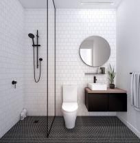 Stylish white subway tile bathroom 23