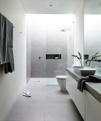 Stylish white subway tile bathroom 28