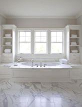 Stylish white subway tile bathroom 29