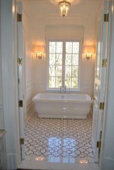 Stylish white subway tile bathroom 31