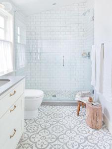 Stylish white subway tile bathroom 32