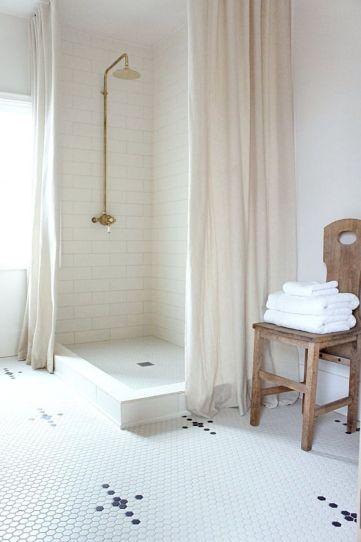 Stylish white subway tile bathroom 39
