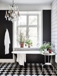 Stylish white subway tile bathroom 40