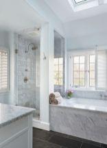 Stylish white subway tile bathroom 41