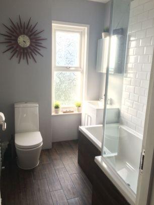Stylish white subway tile bathroom 46