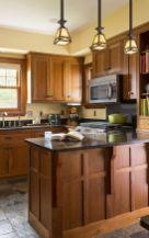 Inspiring black quartz kitchen countertops ideas 26