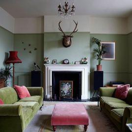 Stylish dark green walls in living room design ideas 15