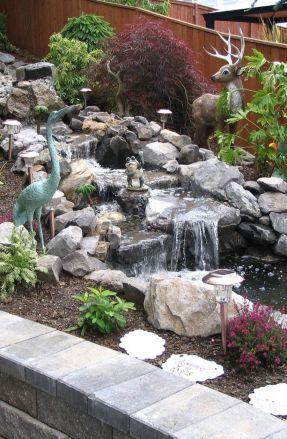 Small backyard waterfall design ideas 36
