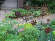Brilliant garden junk repurposed ideas to create artistic landscaping 10
