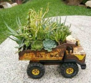 Brilliant garden junk repurposed ideas to create artistic landscaping 30