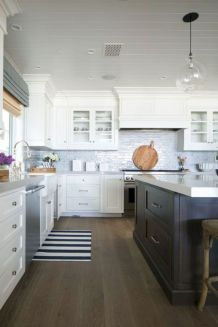 Cozy white kitchen with dark floors 05