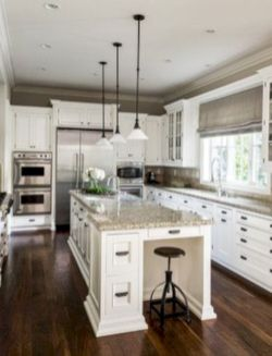 Cozy white kitchen with dark floors 07