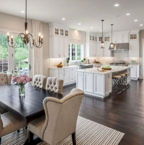 Cozy white kitchen with dark floors 11
