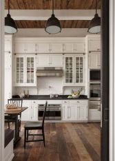 Cozy white kitchen with dark floors 13