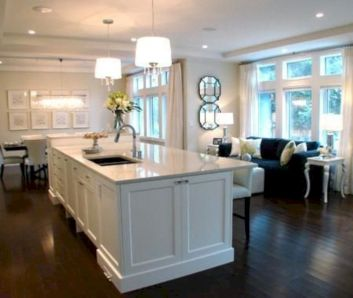 Cozy white kitchen with dark floors 18