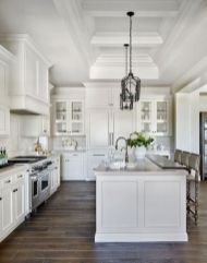 Cozy white kitchen with dark floors 19