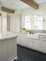 Cozy white kitchen with dark floors 22