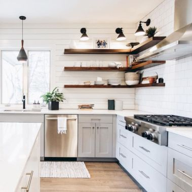 Cozy white kitchen with dark floors 23