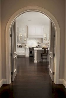 Cozy white kitchen with dark floors 26