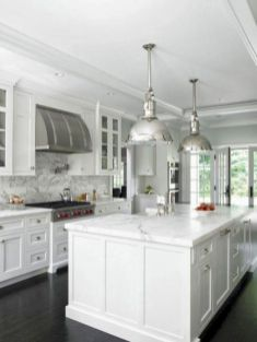 Cozy white kitchen with dark floors 33