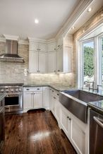 Cozy white kitchen with dark floors 37