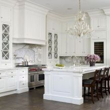 Cozy white kitchen with dark floors 38