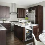 Cozy white kitchen with dark floors 41