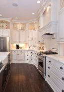 Cozy white kitchen with dark floors 44