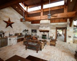 Romantic rustic outdoor kitchen designs with fireplace 02