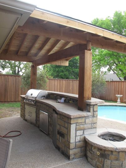 Romantic rustic outdoor kitchen designs with fireplace 25