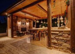 Romantic rustic outdoor kitchen designs with fireplace 45