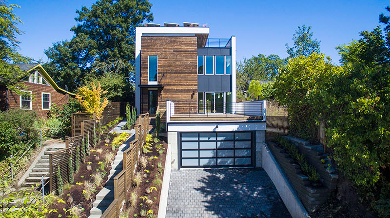 A Tremendous Contemporary House That Features A Green Roof And Solar Panels 1