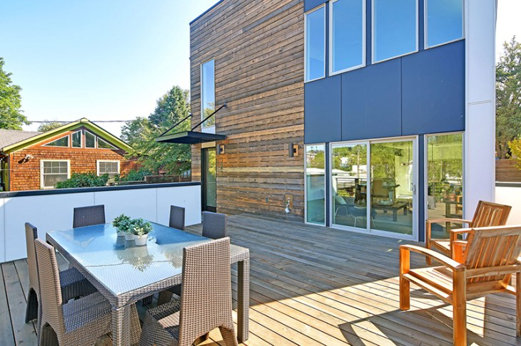 A Tremendous Contemporary House That Features A Green Roof And Solar Panels 8