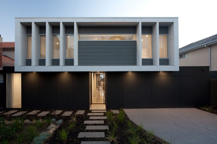 A-house-for-young-family-with-geometric-architecture-and-minimalist-interiors-1