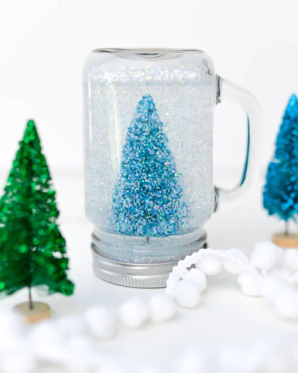 Glittery mason jar snow globes Creative Winter Crafts Ideas That Make Your Snow Day Stay On You