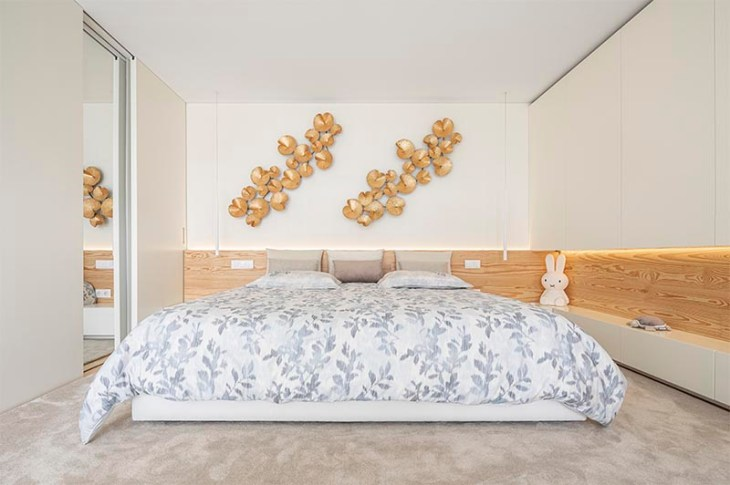 Bedroom with a wrap-around wood accent for a warm glow feeling 1