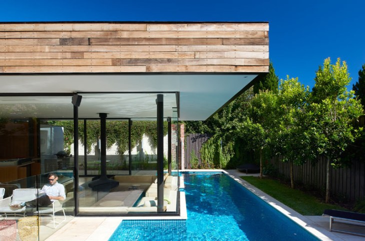 Impressive pool house features a sunken living room with a spa around 4