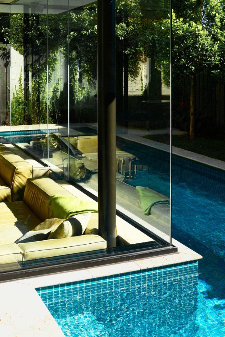 Impressive pool house features a sunken living room with a spa around 7