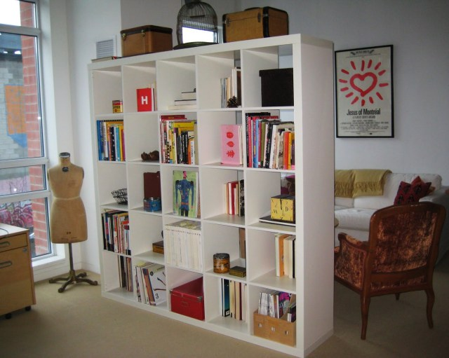 A bookshelf Genius Grand Room Dividers Ideas To Get The Most Out Of Any Space