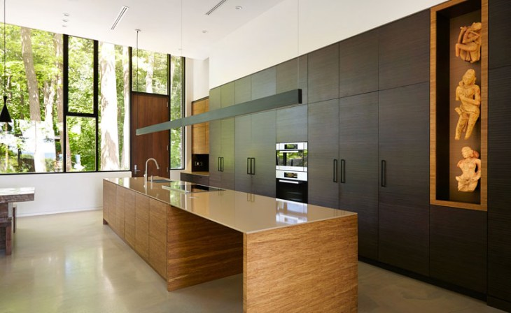 Contemporary home in the forest featuring dark brick exterior 6