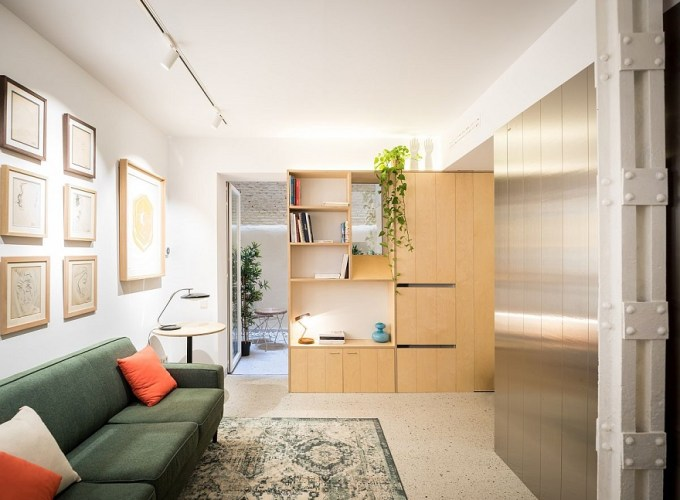 From dark basement unit into space-savvy apartment in ultra-tiny area